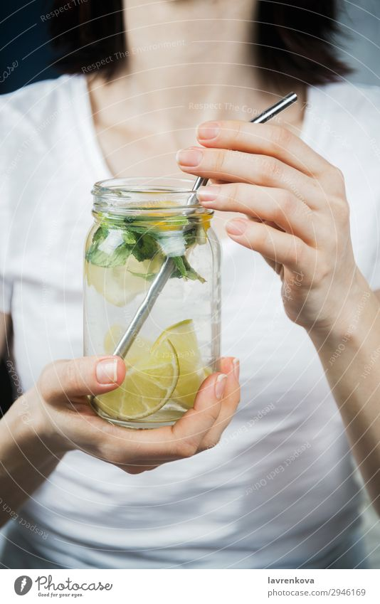 woman holding mason jar with sassy lemon and mint water Straw Metal Lemon Citrus fruits focus Selective Breakfast Beverage Drinking Mint Lime Water Hand Green