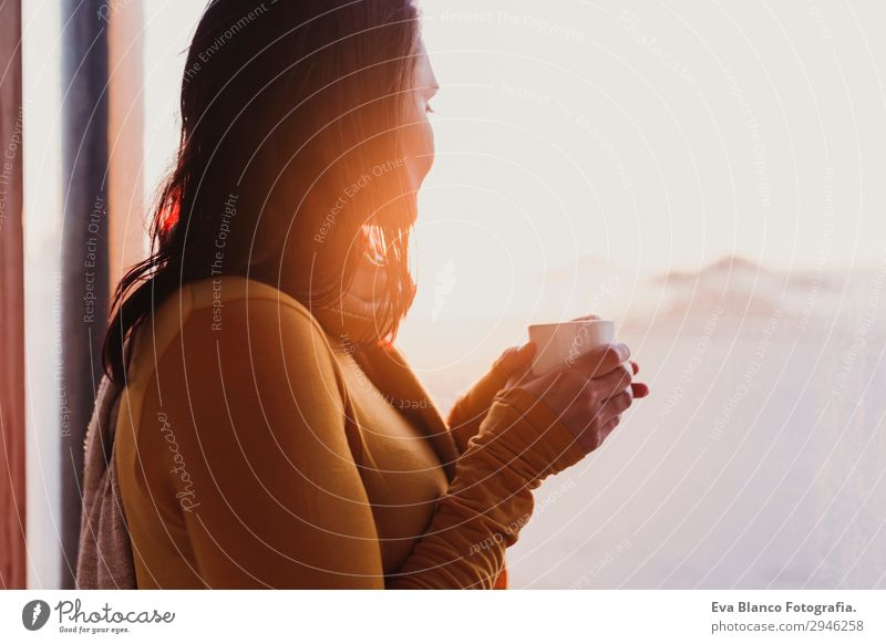 woman enjoys fresh coffee at sunset at the beach Woman Human being Youth (Young adults) Young woman Beautiful Sun Relaxation Beach Window Lifestyle Adults