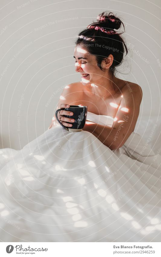 woman on bed enjoying a cup of coffee. morning Beverage Coffee Lifestyle Happy Beautiful Body Relaxation Leisure and hobbies Sun Flat (apartment)