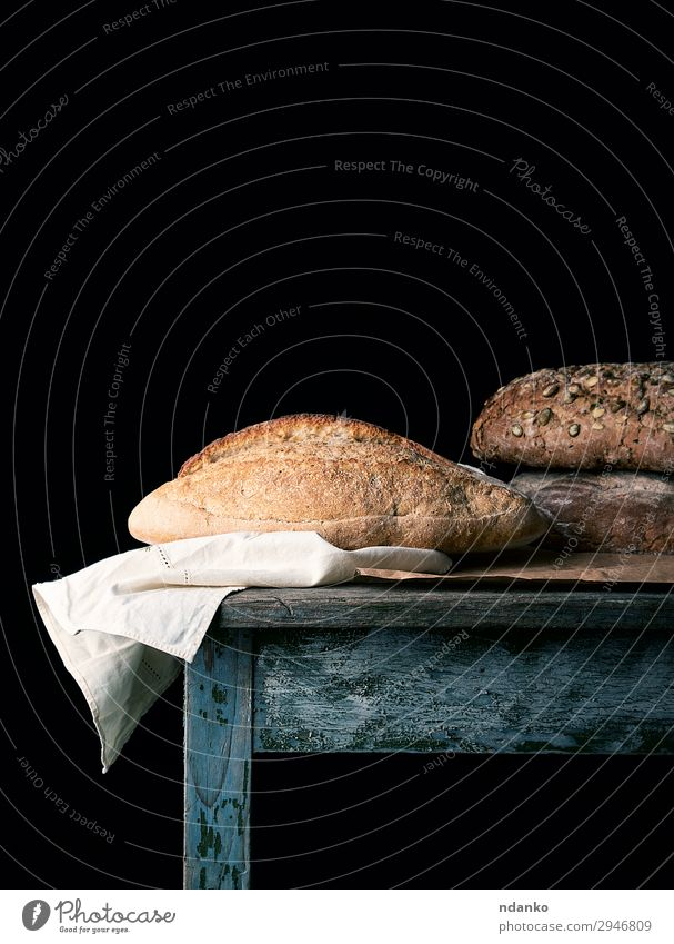 baked loaves of bread on a wooden table Bread Nutrition Eating Breakfast Diet Table Wood Dark Fresh Delicious Natural Brown Black White Tradition Baking Bakery