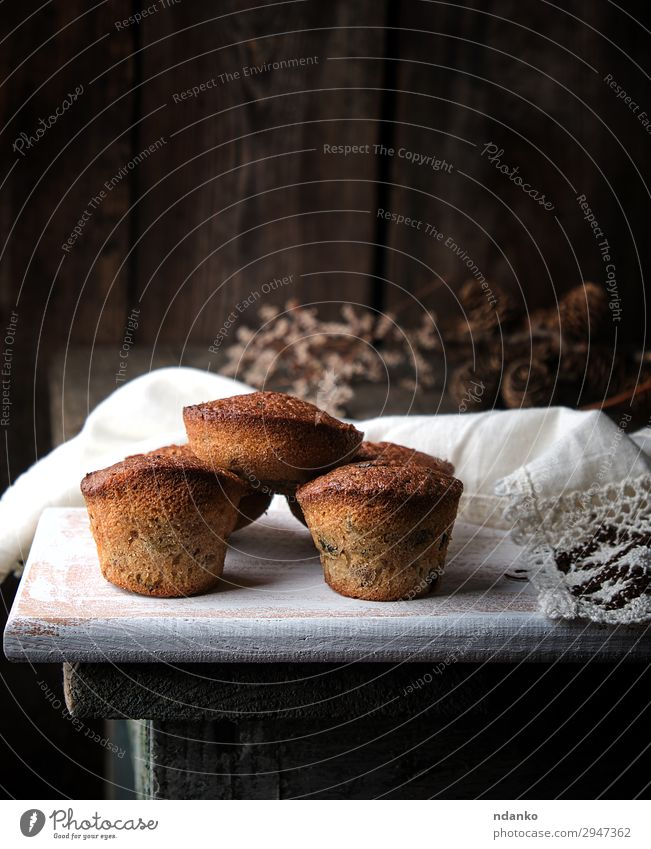baked small cupcakes with dried fruits Fruit Bread Cake Dessert Nutrition Table Wood Eating Fresh Retro Brown White Tradition Baking Bakery board cooking Dried