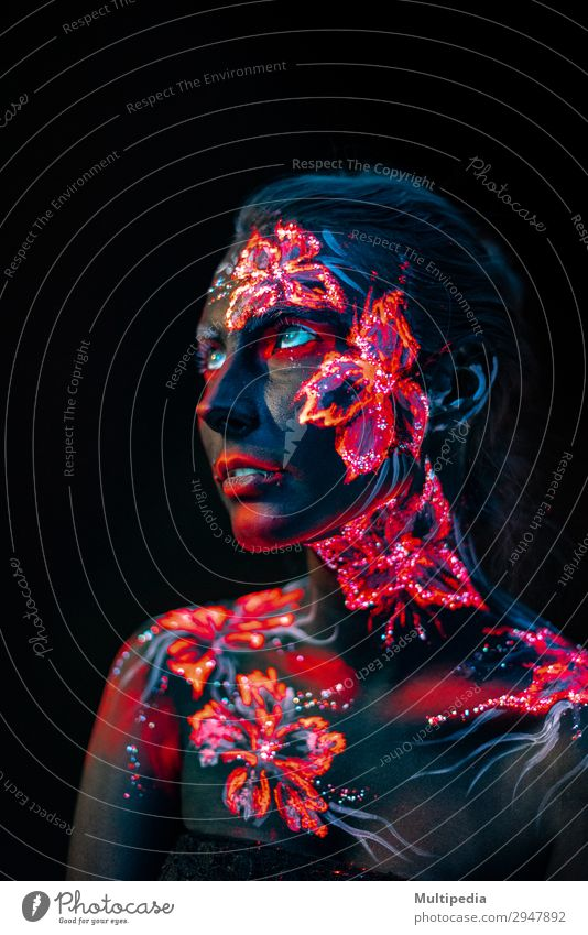 Beautiful flowers in UV light on a young girl face and body Style Body Face Make-up Woman Adults Art Elements Earth Water Flower Love Fantastic Uniqueness Blue
