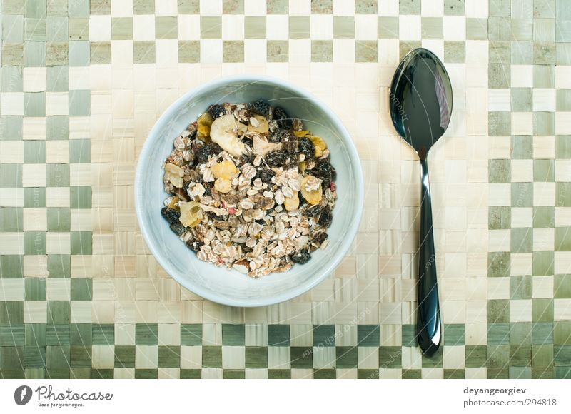 Muesli breakfast in a bowl and spoon Dessert Nutrition Breakfast Vegetarian diet Diet Bowl Spoon Table Energy Cereal grain Meal milk Banana Snack Horizontal