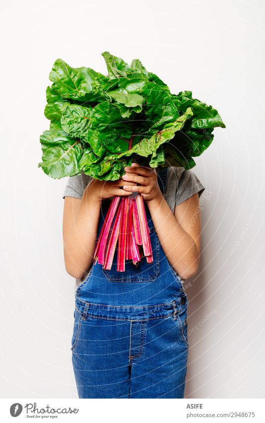 Vegan girl holding a bunch of swiss cahrd Child Green White Red Leaf Natural Nutrition Fresh Vegetable Vegetarian diet Diet Vegan diet Farmer Denim