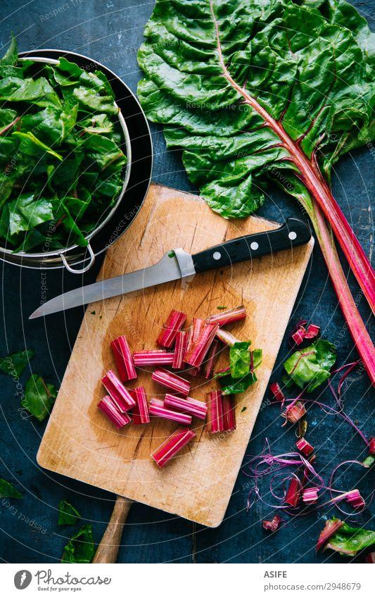 Cooking healthy swiss chard Blue Beautiful Green Red Leaf Wood Nutrition Fresh Vegetable Vegetarian diet Diet Bowl Vegan diet Chopping board Ingredients