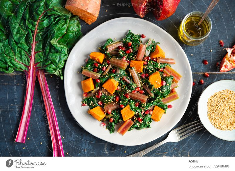 Swiss chard with sweet potato and pomegranate Vegetable Fruit Nutrition Eating Dinner Vegetarian diet Diet Plate Fork Leaf Fresh Delicious Blue Green Red