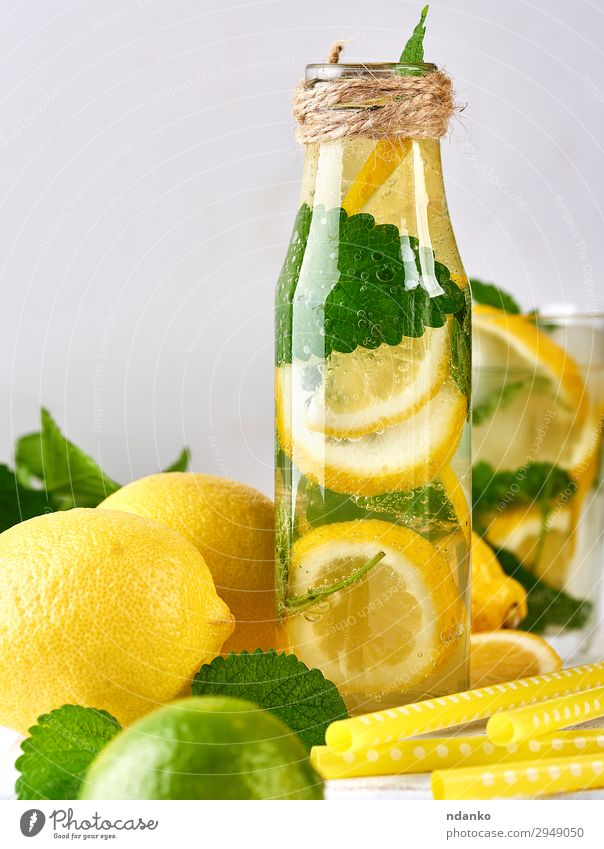 summer refreshing drink lemonade with lemons Fruit Herbs and spices Vegetarian diet Beverage Cold drink Lemonade Juice Alcoholic drinks Bottle Summer Table Leaf