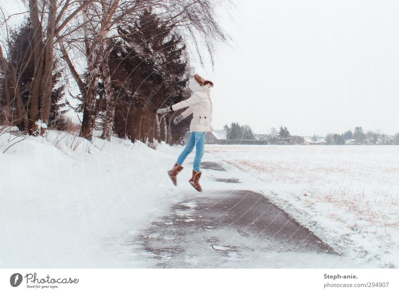 Breaking free 1 Human being Winter Bad weather Ice Frost Snow Tree Field Jeans Coat Hooded (clothing) Gloves Boots Movement Jump Free Uniqueness White Willpower
