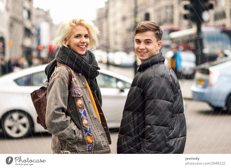 Teenager guy and girl in urban background. Lifestyle Joy Happy Beautiful Vacation & Travel Tourism Sightseeing Human being Masculine Feminine Young woman
