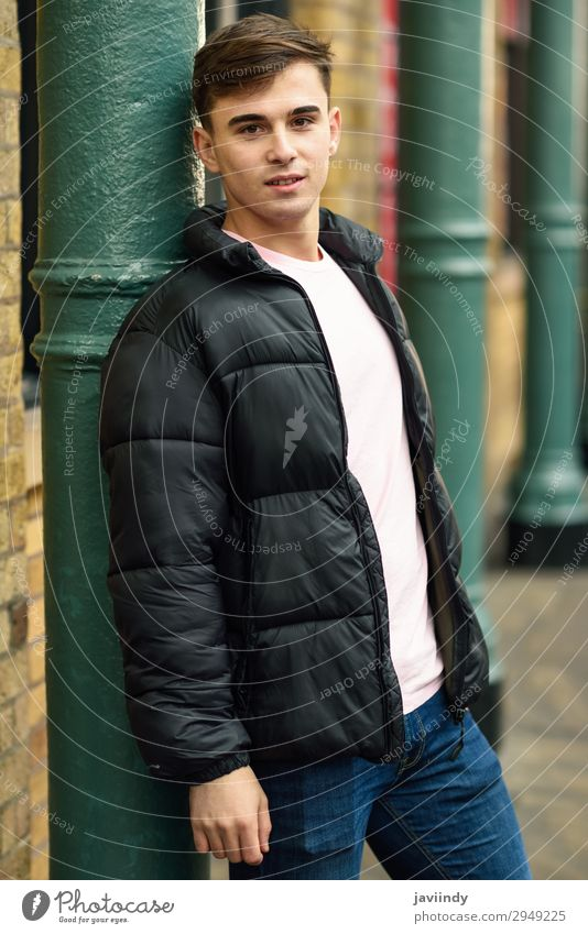 Young man standing in urban background with modern hairstyle. Lifestyle Style Human being Masculine Youth (Young adults) Man Adults 1 18 - 30 years Street