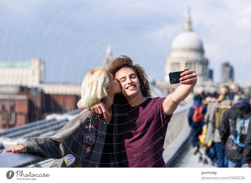 Happy couple taking a selfie on London's Millennium Bridge Woman Human being Vacation & Travel Youth (Young adults) Man Young woman Young man Joy 18 - 30 years