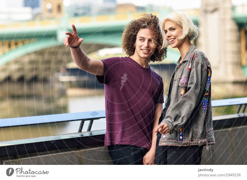 Happy couple talking sitting near River Thames. Joy Hair and hairstyles Vacation & Travel To talk Human being Masculine Feminine Young woman