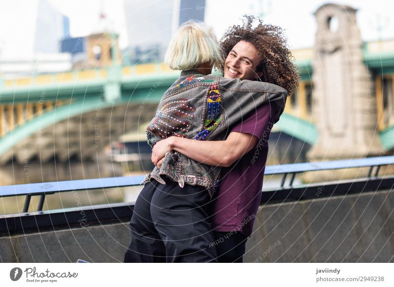 Happy couple hugging near the Southwark bridge Joy Human being Masculine Feminine Young woman Youth (Young adults) Young man Woman Adults Man Friendship Couple