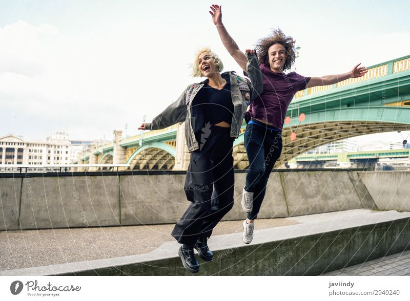 Funny couple jumping near River Thames, London Joy Happy Beautiful Vacation & Travel Human being Masculine Feminine Young woman Youth (Young adults) Young man