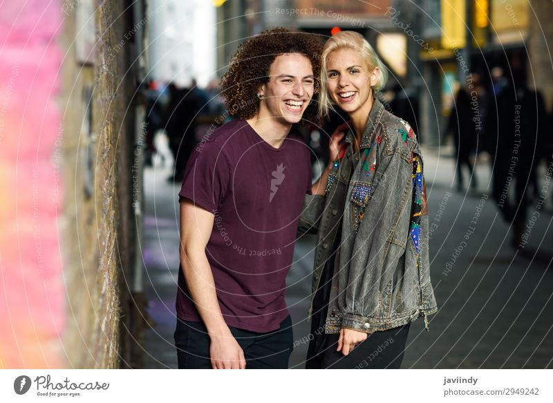 Young couple talking in urban background Lifestyle Joy Happy Beautiful Hair and hairstyles To talk Human being Masculine Feminine Young woman