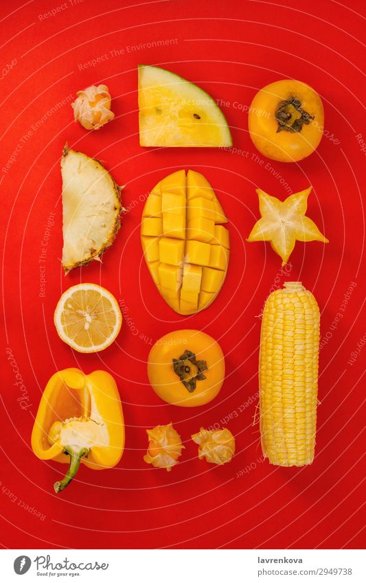 various yellow and orange fruits and vegetables on red Healthy Eating Red Fruit Fresh Lemon Pepper Cut Pineapple Mango Citrus fruits Physalis Water melon Corny