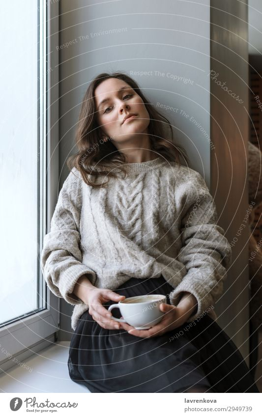 woman in sweater holding cup with latte Attractive Café Casual clothes Caucasian Close-up Coffee Cup Beverage Drinking Woman Shallow depth of field Young woman