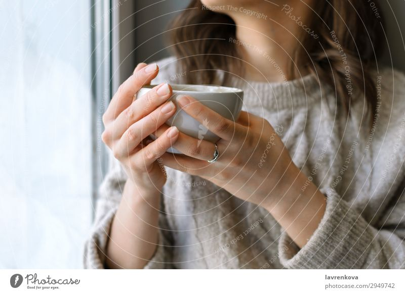 woman's holding cup with latte in front of the window Café Close-up Coffee Cup Beverage Drinking Woman Shallow depth of field Young woman Home Hot hygge