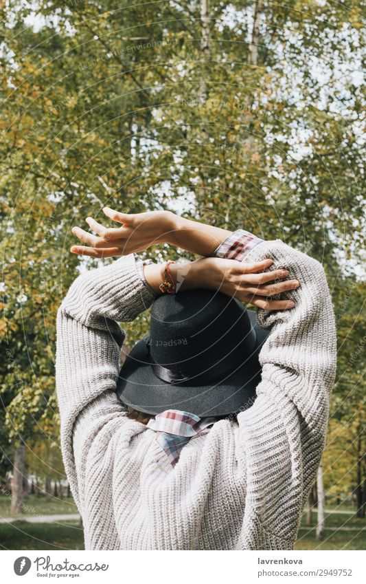 back of young female in sweater and hat Woman Vacation & Travel Nature Young woman Summer Green Hand Loneliness Leaf Forest 18 - 30 years Lifestyle Adults