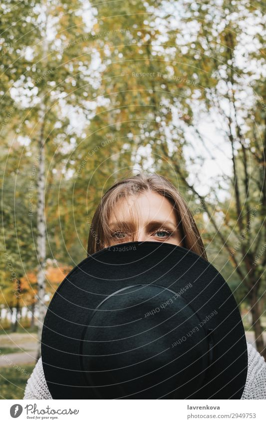 woman covering half of her face hat Woman Young woman Loneliness Leaf Forest 18 - 30 years Eyes Lifestyle Adults Autumn Fashion Park Hair Cute To go for a walk