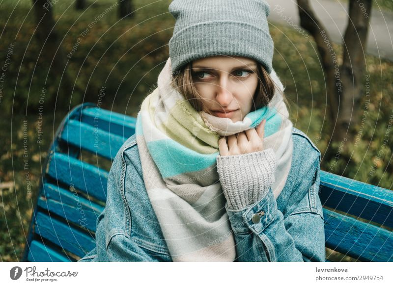 young adult woman sitting on a bench wrapped in scarf Woman Nature Young woman Beautiful White Tree Loneliness Forest Winter 18 - 30 years Lifestyle Adults