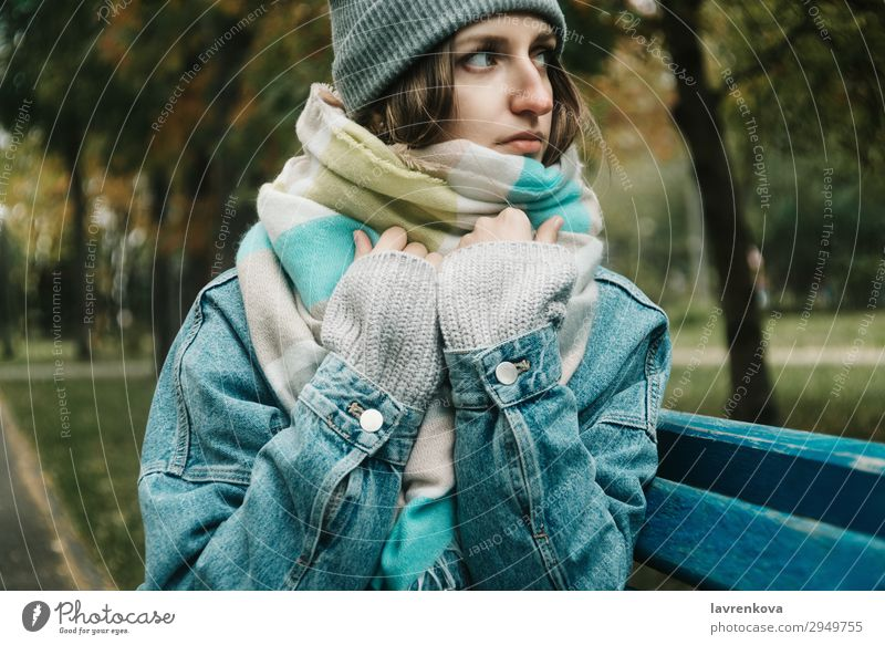 young adult woman sitting on a bench wrapped in scarf Woman Nature Young woman White Tree Loneliness Forest Winter 18 - 30 years Lifestyle Adults Autumn Cold