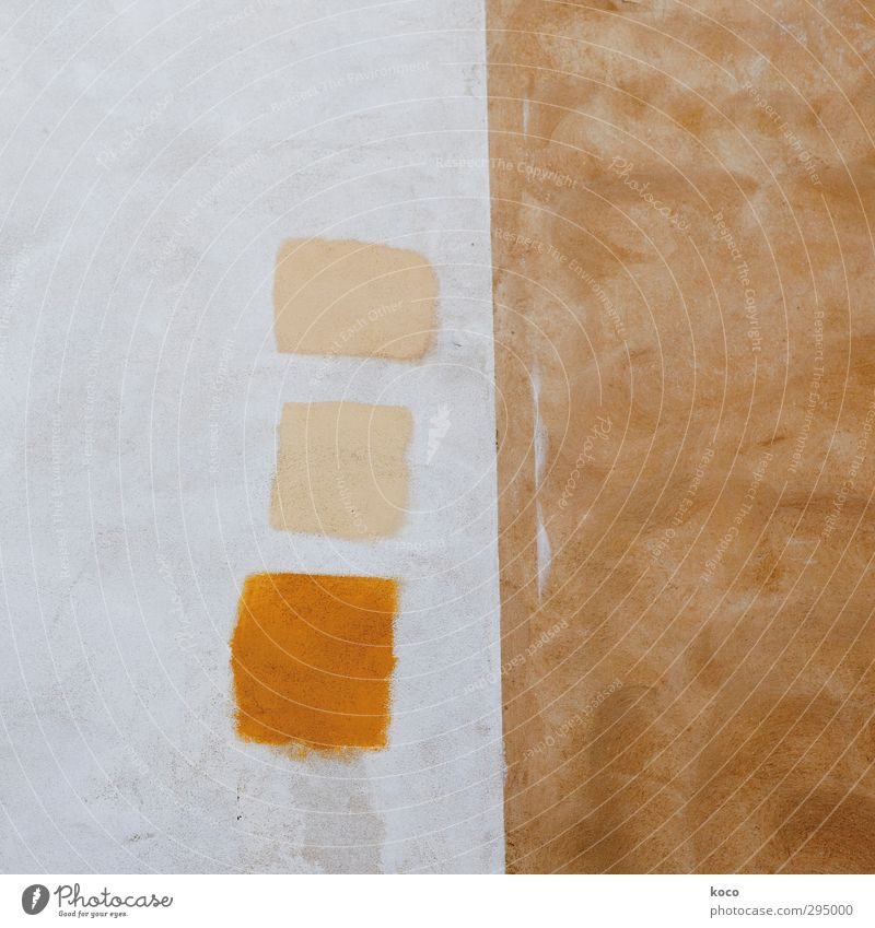 three squares Wall (barrier) Wall (building) Facade Square Rectangle At right angles Line Sharp-edged Simple Cute Brown Yellow Orange White Relationship Equal