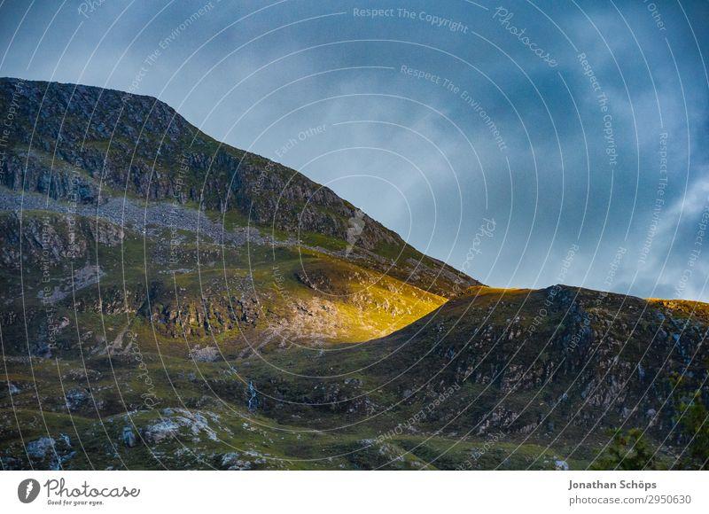 last sunbeam at the mountain Highlands, Scotland Environment Nature Landscape Elements Sky Sunrise Sunset Sunlight Beautiful weather Rock Mountain Esthetic