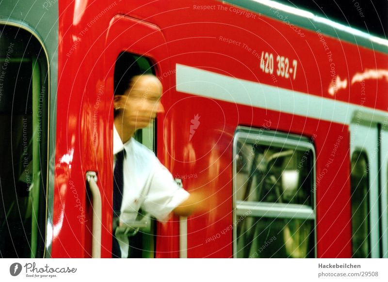 Human being Red Work and employment Railroad Underground Public transit Photographic technology Ticket collector