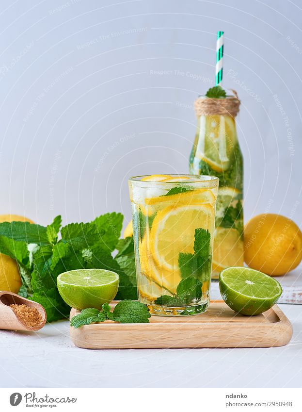 summer refreshing drink lemonade with lemons Fruit Herbs and spices Beverage Cold drink Lemonade Juice Alcoholic drinks Bottle Glass Summer Table Leaf