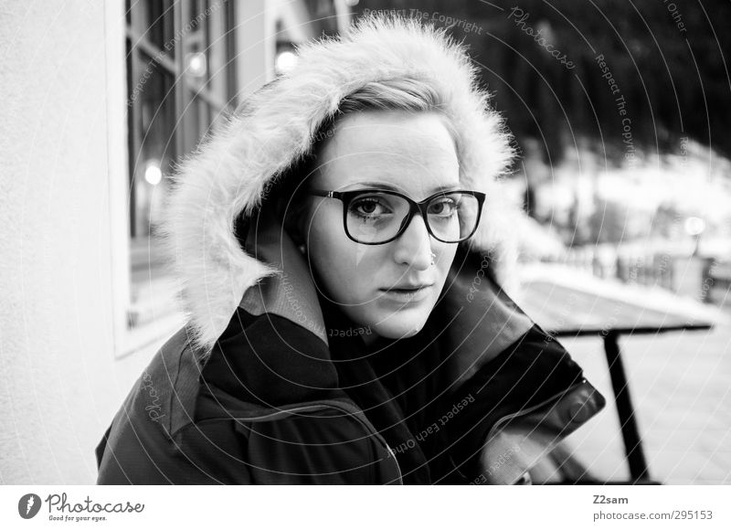 L Feminine Young woman Youth (Young adults) 1 Human being 18 - 30 years Adults Winter Snow Jacket Hooded (clothing) Piercing Eyeglasses Blonde Relaxation Sit