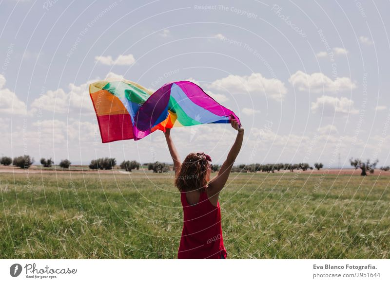 Woman holding the Gay Rainbow Flag on green meadow outdoors Human being Sky Nature Youth (Young adults) Young woman Summer Blue Colour Green Red Sun Clouds Joy