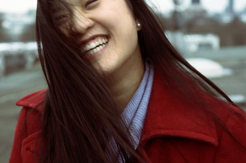 be happy! Young woman Youth (Young adults) Head Hair and hairstyles 18 - 30 years Adults Coat Black-haired Long-haired Smiling Laughter Stand Illuminate