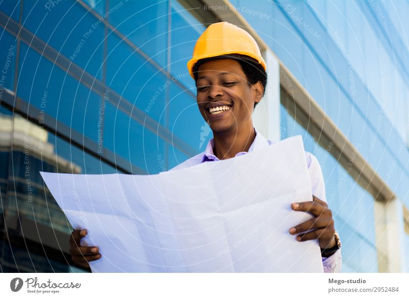 Businessman engineer developer holding blueprint Human being Man Black Architecture Adults Building Work and employment Office Modern Smiling Industry Safety