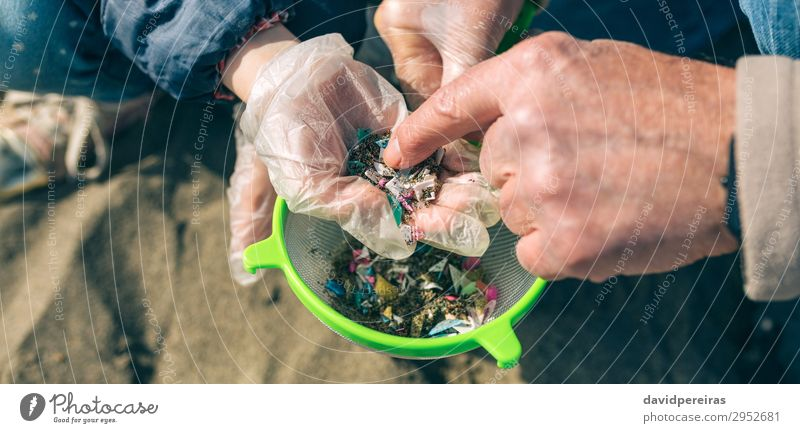 Colander with microplastics on the beach Beach Child Internet Human being Woman Adults Man Grandfather Family & Relations Hand Environment Sand Sieve Plastic