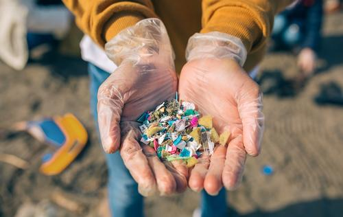 Hands with microplastics on the beach Human being Man Old Beach Adults Environment Sand Dangerous Plastic Indicate Trash Teamwork Horizontal
