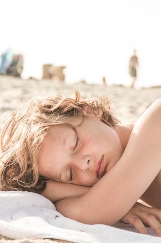 Human being Child Vacation & Travel Summer Sun Calm Beach Relaxation Face Life Boy (child) Hair and hairstyles Sand Head Bright Dream