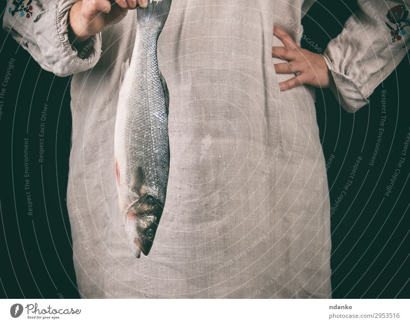 woman in gray clothes holding a fresh sea bass fish Fish Seafood Kitchen Human being Woman Adults Hand 1 18 - 30 years Youth (Young adults) Make Stand Fresh