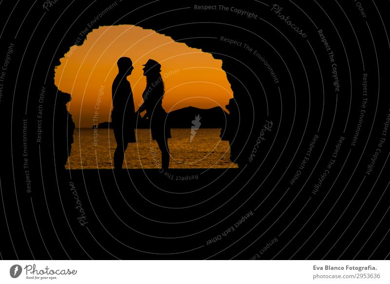 silhouette of young couple loving at the beach at sunset Woman Human being Sky Vacation & Travel Youth (Young adults) Man Young woman Summer Young man Sun Ocean