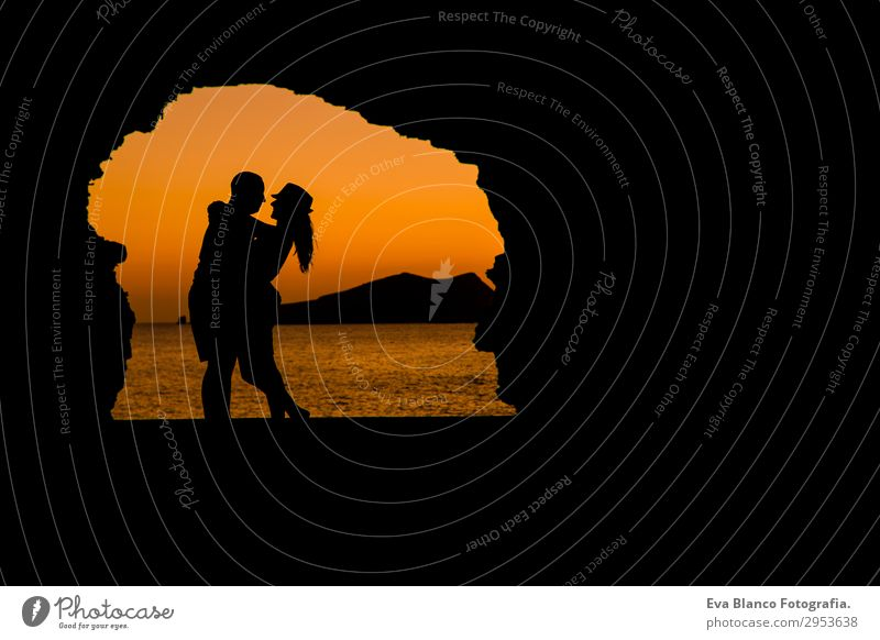 silhouette of young couple loving at the beach at sunset Woman Human being Sky Vacation & Travel Youth (Young adults) Man Young woman Summer Beautiful Young man