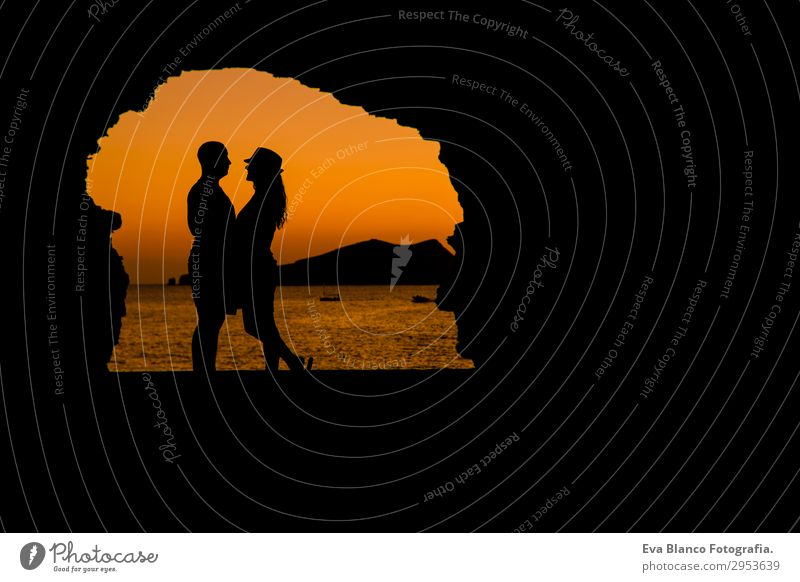 silhouette of young couple loving at the beach at sunset Woman Human being Sky Vacation & Travel Youth (Young adults) Man Young woman Young man Landscape Sun