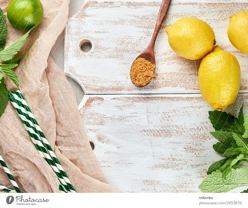ripe yellow whole lemons and lime Fruit Herbs and spices Nutrition Vegetarian diet Lemonade Juice Spoon Summer Table Plant Leaf Tube Wood Fresh Natural Above