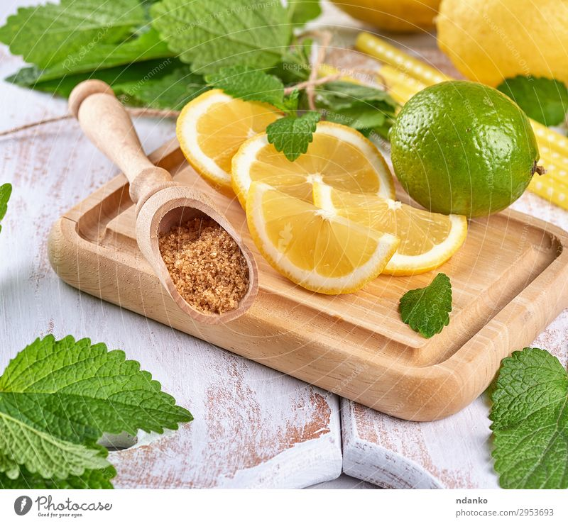 ripe yellow lemons and lime, brown sugar Fruit Herbs and spices Lemonade Juice Spoon Summer Table Leaf Tube Wood Make Fresh Above Juicy Brown Yellow Green White