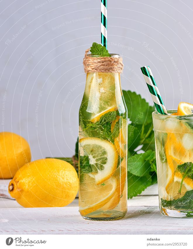 summer refreshing drink lemonade Fruit Herbs and spices Vegetarian diet Beverage Cold drink Lemonade Juice Alcoholic drinks Bottle Glass Summer Table Leaf
