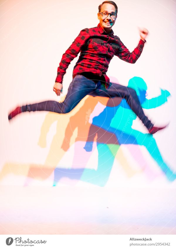 young man jumps into the air with three-coloured shadow 1 Person Young man Man Masculine Jump Unicoloured Feasts & Celebrations Rocking out Wild Exuberance Romp