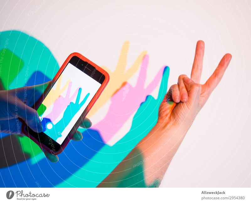 two finger gesture Peace Hand Gesture two fingers Multicoloured Yellow Magenta Cyan Salutation two beers Hare & Rabbit & Bunny Neutral Background Isolated Image