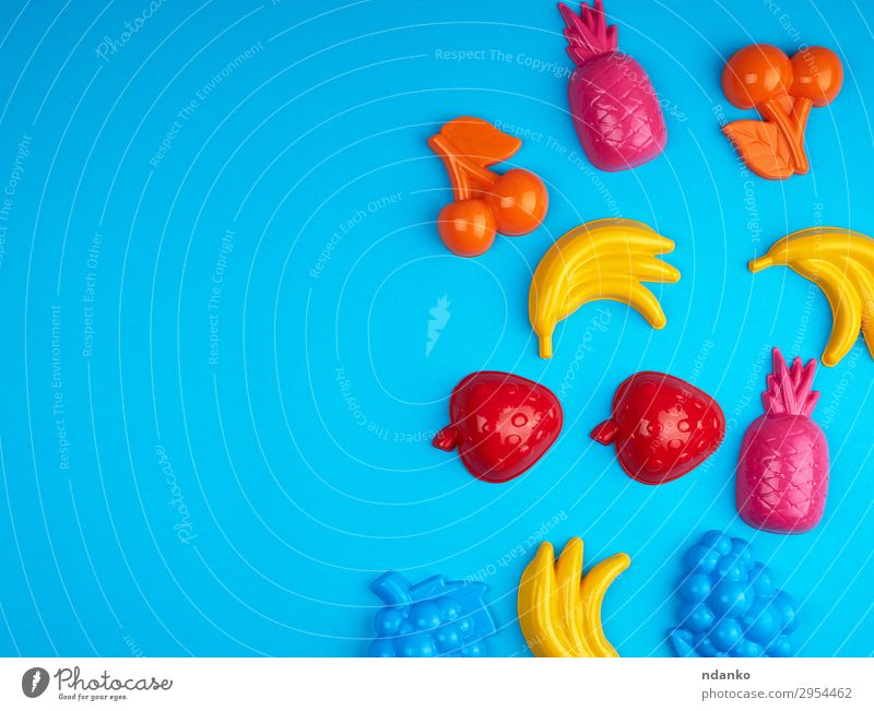 multicolored plastic toys fruits on a blue background Child Summer Blue Colour Green Red Joy Yellow Playing Pink Fruit Design Decoration Bright Infancy