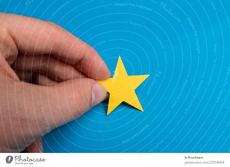 yellow star Man Adults Hand Fingers Paper Decoration Sign Select Touch Movement To hold on Blue Yellow Idyll Uniqueness Inspiration Star (Symbol) 1
