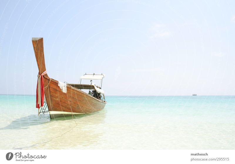 Sky Vacation & Travel Water Summer Sun Ocean Calm Beach Relaxation Warmth Coast Swimming & Bathing Sand Air Waves Island