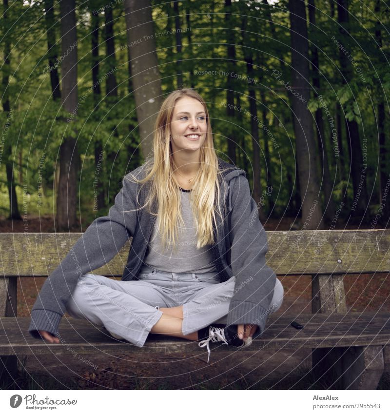Blonde girl sitting on a bench in the woods Joy Beautiful Wellness Life Leisure and hobbies Young woman Youth (Young adults) 18 - 30 years Adults Environment